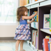 Girl getting book of shelf smaller flipped