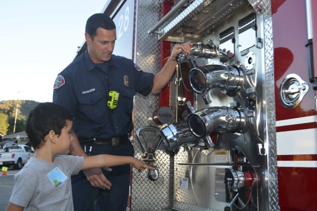 firefighter talking with kid