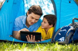 dad and boy in tent