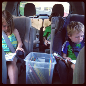 kid-reading-in-the-car 2